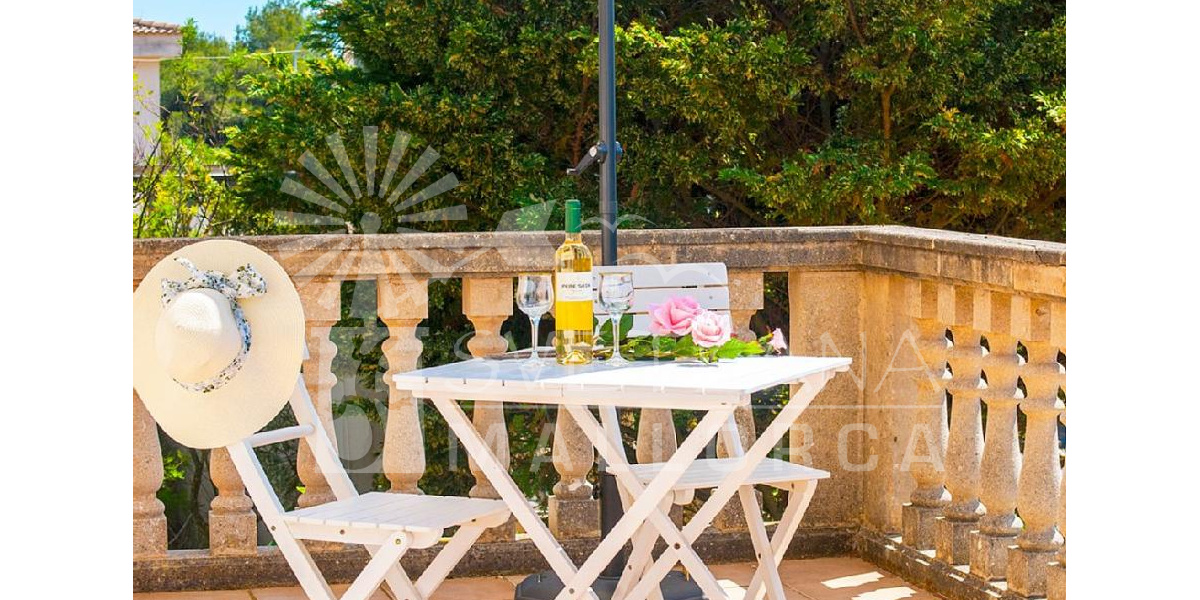Enjoy a good wine on the porch is a luxury at your fingertips in this villa..
