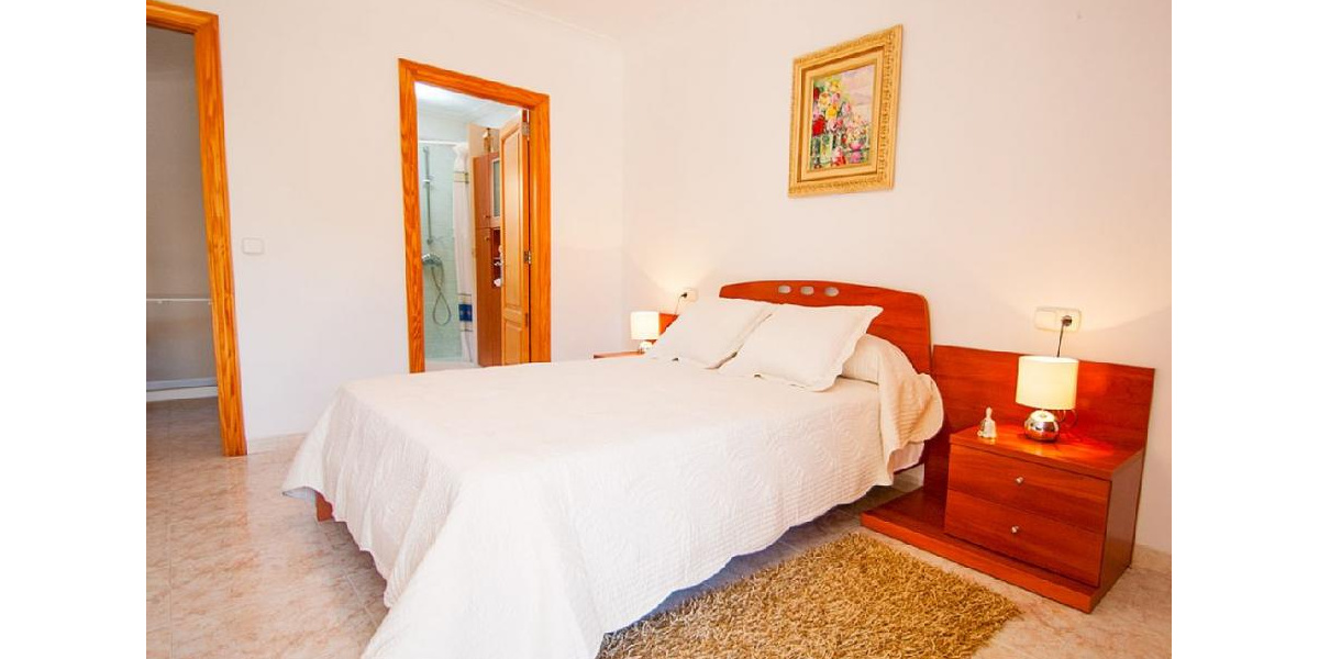 The pretty White Double Bedroom has en suite bathroom and terrace.