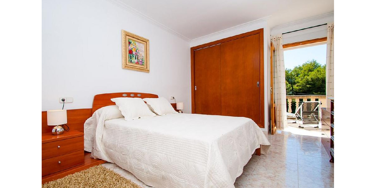 Beautiful White Double Bedroom with large comfortable bed and sunny terrace.