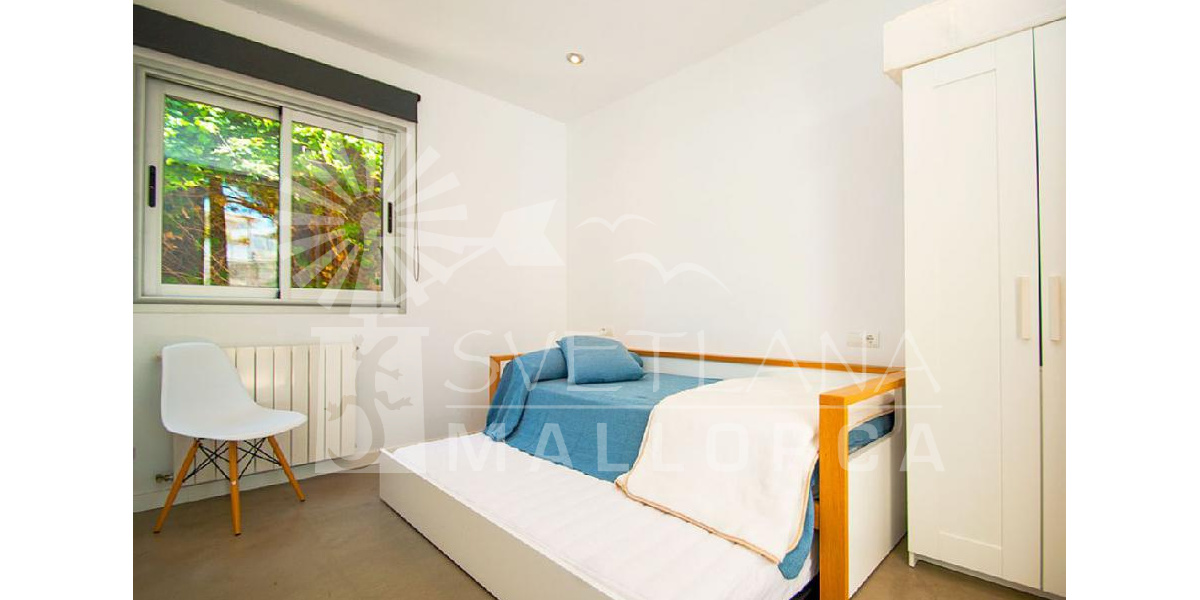 Spacious bedroom with two beds nest located on the ground floor of the house.