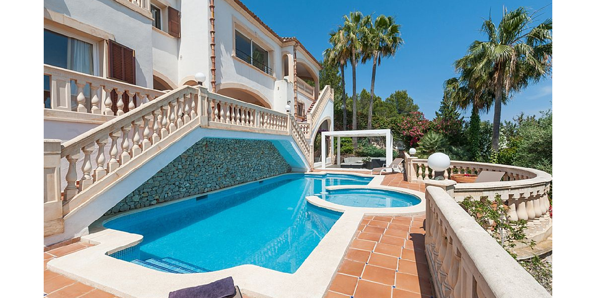 Fabulous swimming pool with adults and children, hammocks line and sea views.