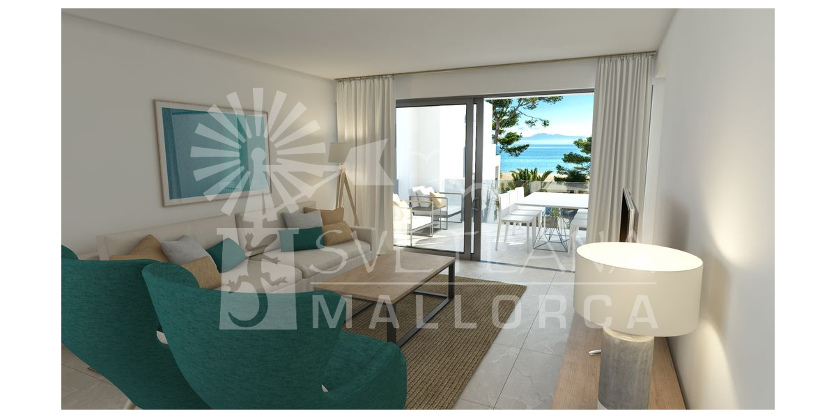 Living room with comfortable sofas and exit to the terrace with views to the sea and the beach.